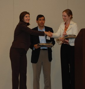 Penny Warga presenting the Arthur Warga Best Paper Award to Carolin Pflueger and Luis M. Viceira.